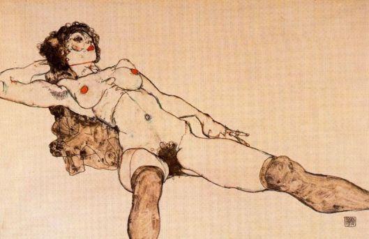 Desnudo femenino acostado con las piernas separadas