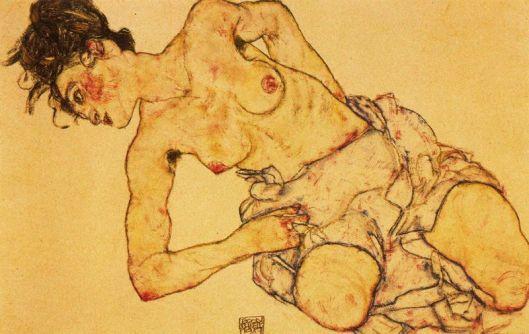Semidesnudo femenino de rodillas
